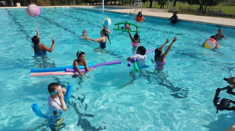 YWCA campers swim in a pool