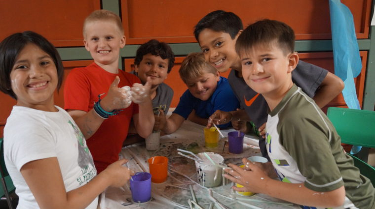 Children in summer camp doing science experiment