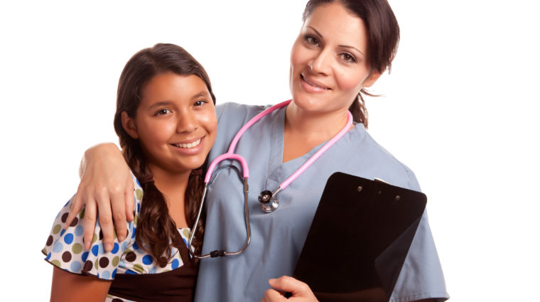 Pretty Hispanic Girl And Female Doctor Isolated