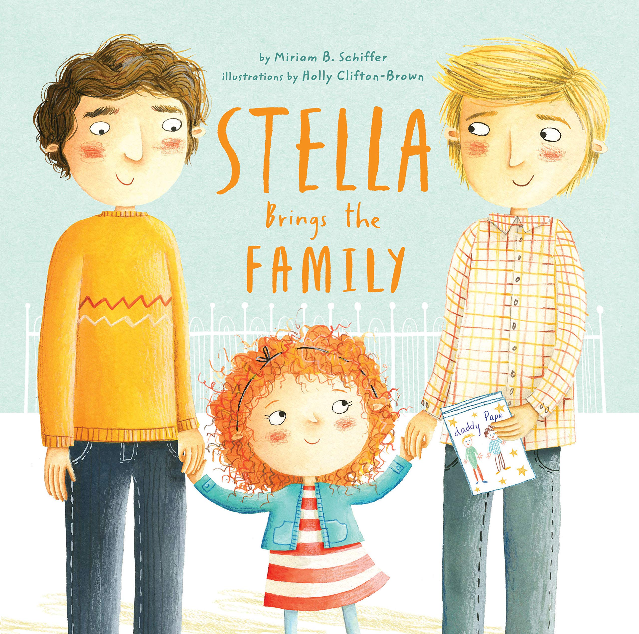 A young girl with curly red hair, wearing a red and white striped dress and blue cardigan stands between two men holding their hands. The man on the left is wearing a yellow sweater and has brown hair and the man on the right has blonde hair and is wearing a checkered shirt. Between the men sis the book's title: Stella Brings the Family