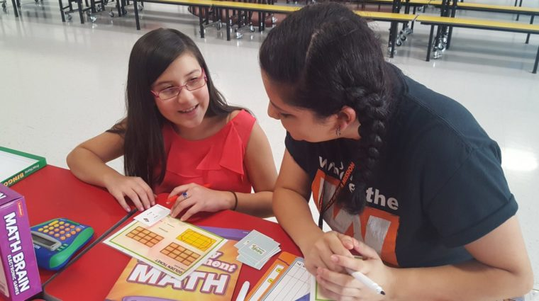 an after school student and instructor playing a math game