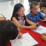 YWCA students working on math homework using calculators